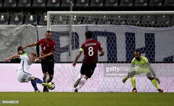 Omer Toprak and Selcuk Inan of Turkey in action against Joel Pohjanpalo of Finland during the 2018 FIFA World Cup European Qualification Group I...