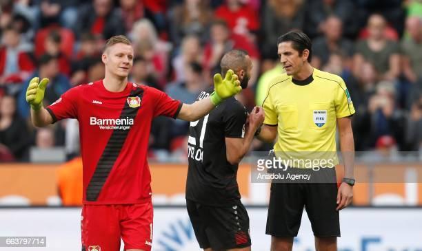 LEVERKUSEN GERMANY APRIL 2 Omer Toprak and Torwart Bernd Leno of Leverkusen talk to referee Deniz Aytekin during the Bundesliga soccer match between...