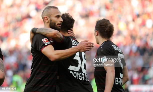 LEVERKUSEN GERMANY APRIL 2 Omer Toprak Karim Bellarabi and Julian Baumgartlinger of Leverkusen celebrate the 10 against Wolfsburg during the...
