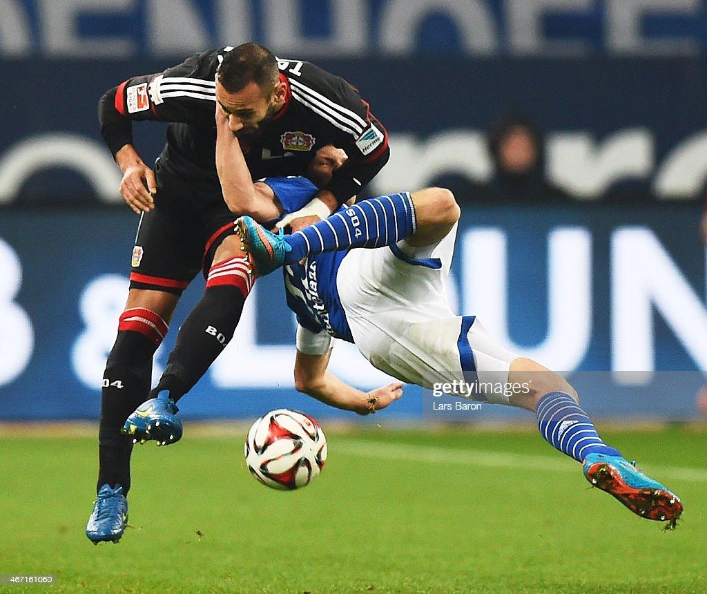 Omer Toprak of Bayer 04 Leverkusen tangles with Klaas-Jan Huntelaar of FC Schalke 04 during the Bundesliga match between FC Schalke 04 and Bayer 04 Leverkusen at Veltins Arena on March 21, 2015 in Gelsenkirchen, Germany.