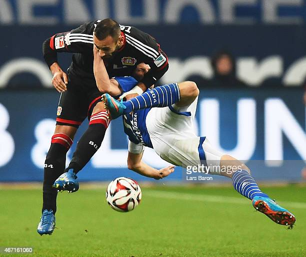 Omer Toprak of Bayer 04 Leverkusen tangles with KlaasJan Huntelaar of FC Schalke 04 during the Bundesliga match between FC Schalke 04 and Bayer 04...