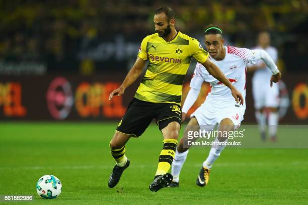 Omer Toprak of Borussia Dortmund battles for the ball with Yussuf Poulsen of RB Leipzig during the Bundesliga match between Borussia Dortmund and RB...