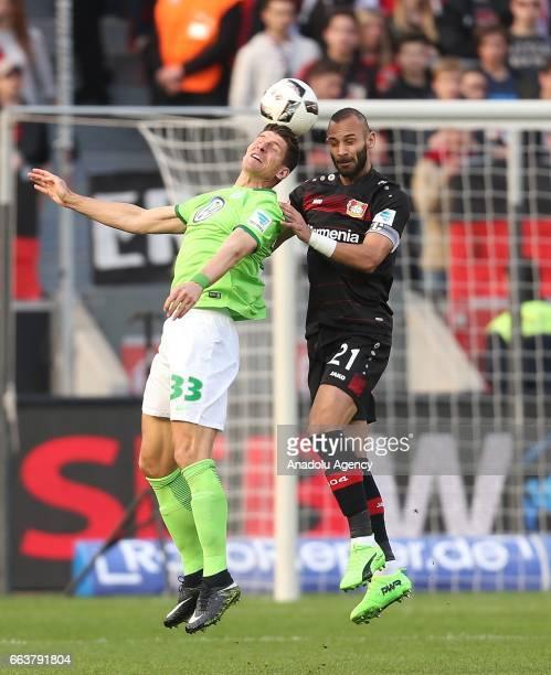 Omer Toprak of Leverkusen challenges with Mario Gomez during the Bundesliga soccer match between Bayer Leverkusen and VfL Wolfsburg at the BayArena...