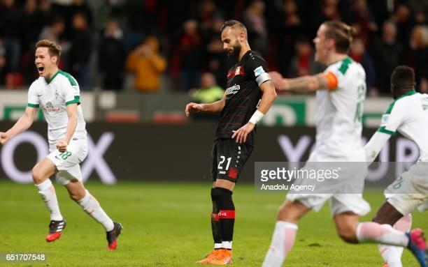 Omer Toprak of Leverkusen fails a penalty while Milos Veljkovic and Max Kruse of Bremen celebrate during the Bundesliga soccer match between Bayer...