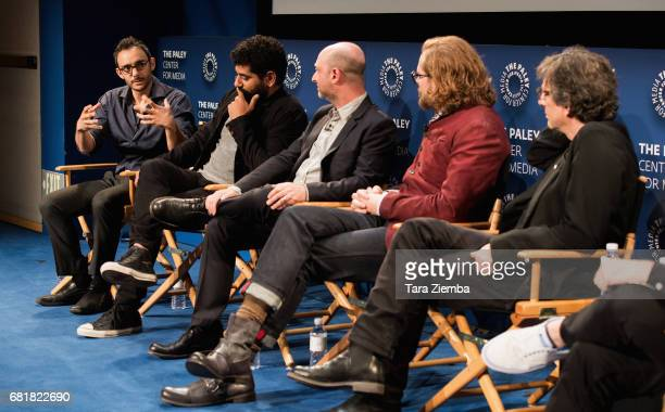 Omid Abtahi Mousa Kraish Michael Green Bryan Fuller and Neil Gaiman speak onstage during the QA after the 'American Gods' advance screening In...