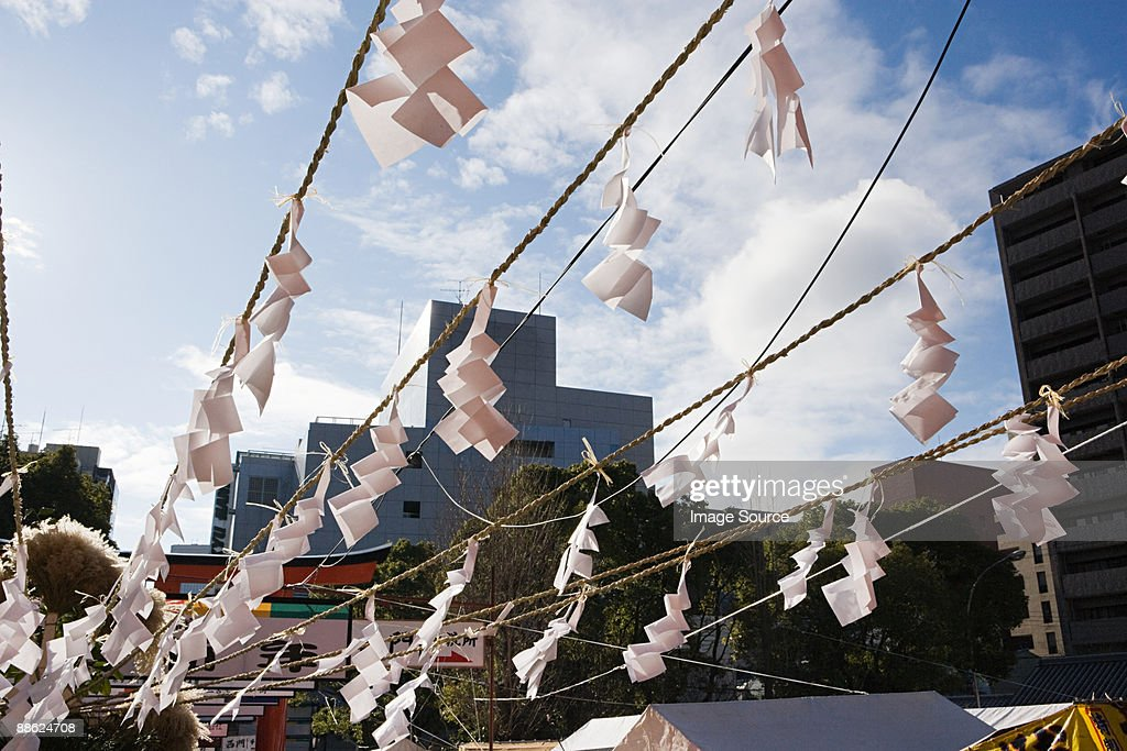Omikuji on a rope at a shrine : Stock Photo