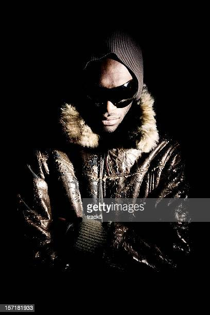 Ominous fashion portrait of a dramatically lit black male model