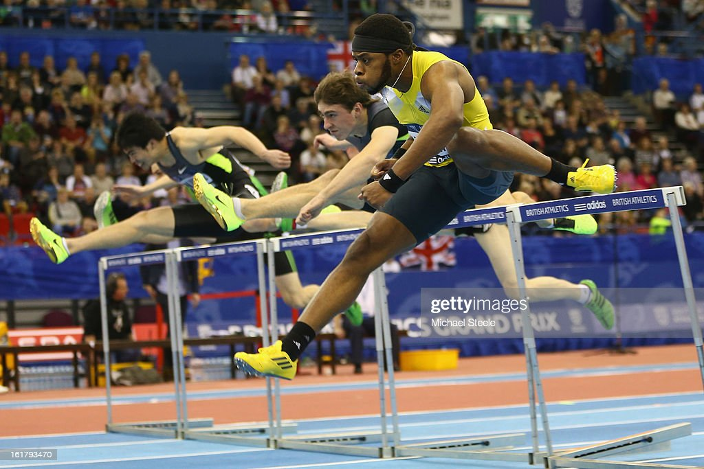 Omo Osaghae (R) of USA clears the last hurdle to win the men's 60m hurdles final during the British Athletics Grand Prix at the National Indoor Arena on February 16, 2013 in Birmingham, England.