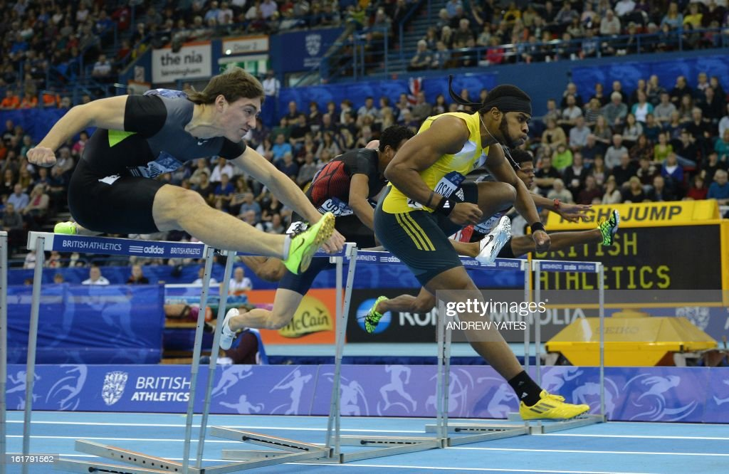 Omo Osaghe of the US (R) clears the final hurdle to win the mens 60 metres hurdles during the British Athletics Grand Prix at the National Indoor Arena in Birmingham, central England on February 16, 2013.