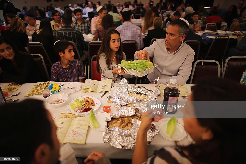 Omri Brandes, Nitzan Brandes and Bentsi Brandes (L-R) eat during a community Passover Seder at Beth Israel synagogue on March 25, 2013 in Miami Beach, Florida. The community Passover Seder that served around 150 people has been held for the past 30 years and is welcome to anyone in the community that wants to commemorate the emancipation of the Israelites from slavery in ancient Egypt.