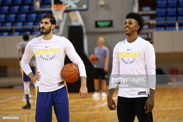 Omri Casspi and Nick Young of the Golden State Warriors look on during practice and media availability at Shenzhen Gymnasium as part of 2017 NBA...