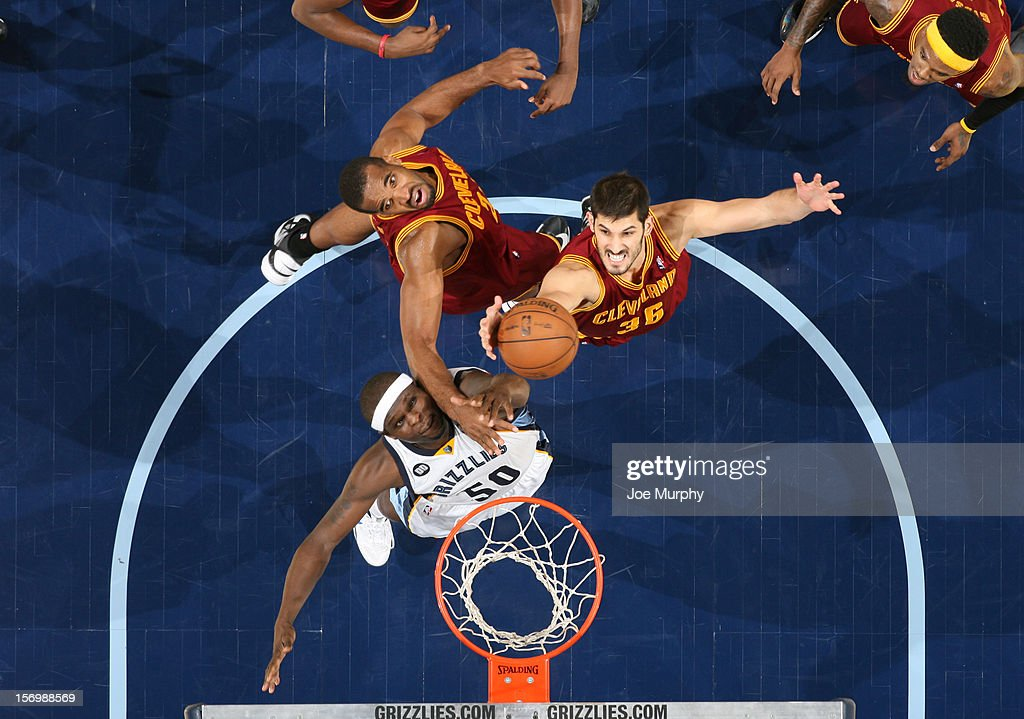 <a gi-track='captionPersonalityLinkClicked' href=/galleries/search?phrase=Omri+Casspi&family=editorial&specificpeople=2298404 ng-click='$event.stopPropagation()'>Omri Casspi</a> #36 and <a gi-track='captionPersonalityLinkClicked' href=/galleries/search?phrase=Samardo+Samuels&family=editorial&specificpeople=5042441 ng-click='$event.stopPropagation()'>Samardo Samuels</a> #24 of the Cleveland Cavaliers rebound against <a gi-track='captionPersonalityLinkClicked' href=/galleries/search?phrase=Zach+Randolph&family=editorial&specificpeople=201595 ng-click='$event.stopPropagation()'>Zach Randolph</a> #50 of the Memphis Grizzlies on November 26, 2012 at FedExForum in Memphis, Tennessee.