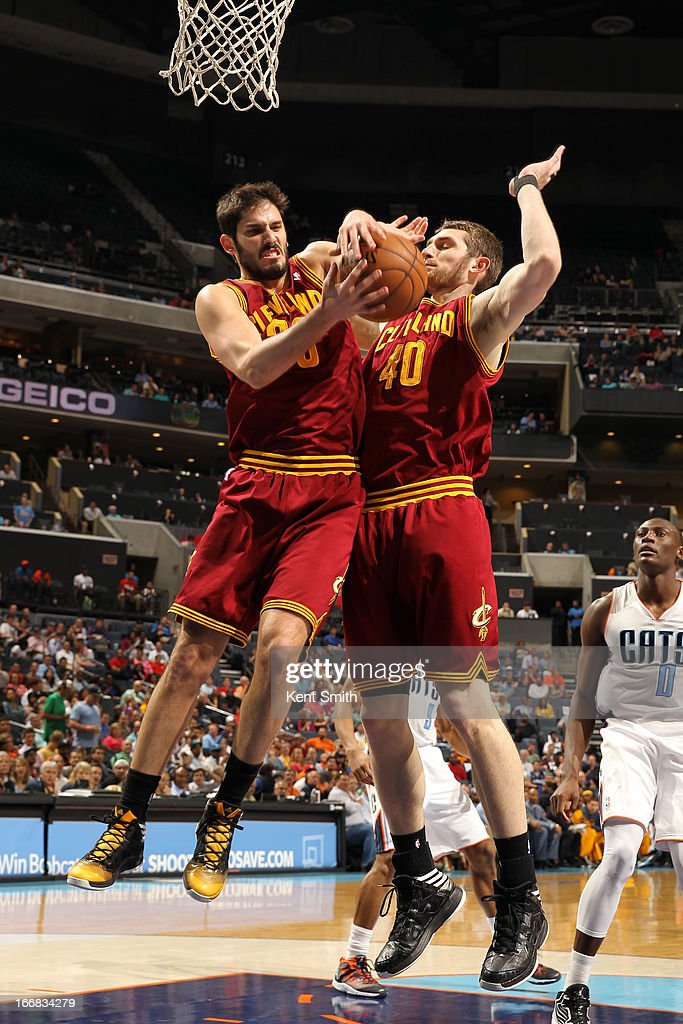 Omri Casspi #36 and Tyler Zeller #40 of the Cleveland Cavaliers go for a rebound against the Charlotte Bobcats at the Time Warner Cable Arena on April 17, 2013 in Charlotte, North Carolina.