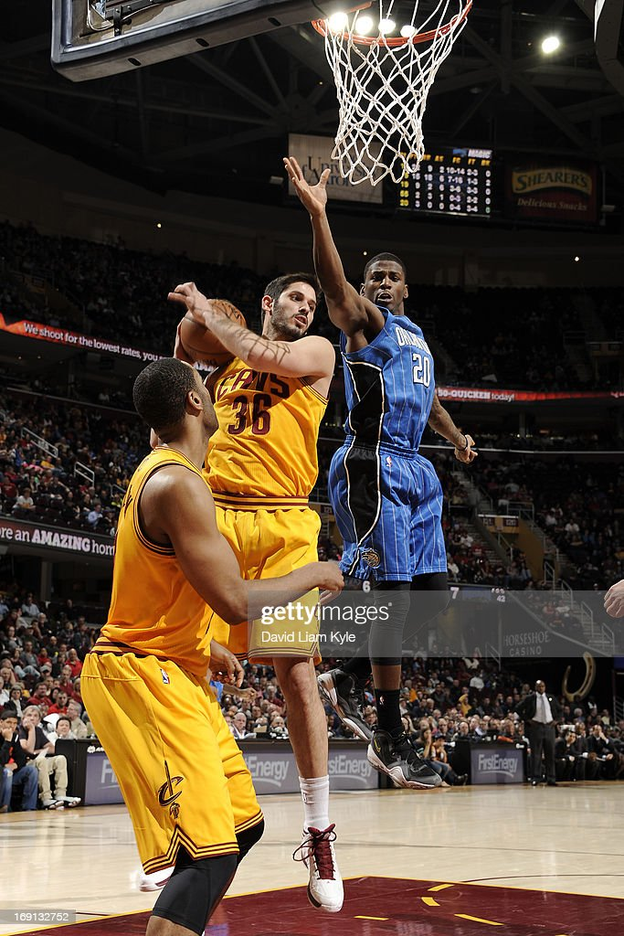 Omri Casspi #36 of the Cleveland Cavaliers grabs a rebound against DeQuan Jones #20 of the Orlando Magic at The Quicken Loans Arena on April 7, 2013 in Cleveland, Ohio.