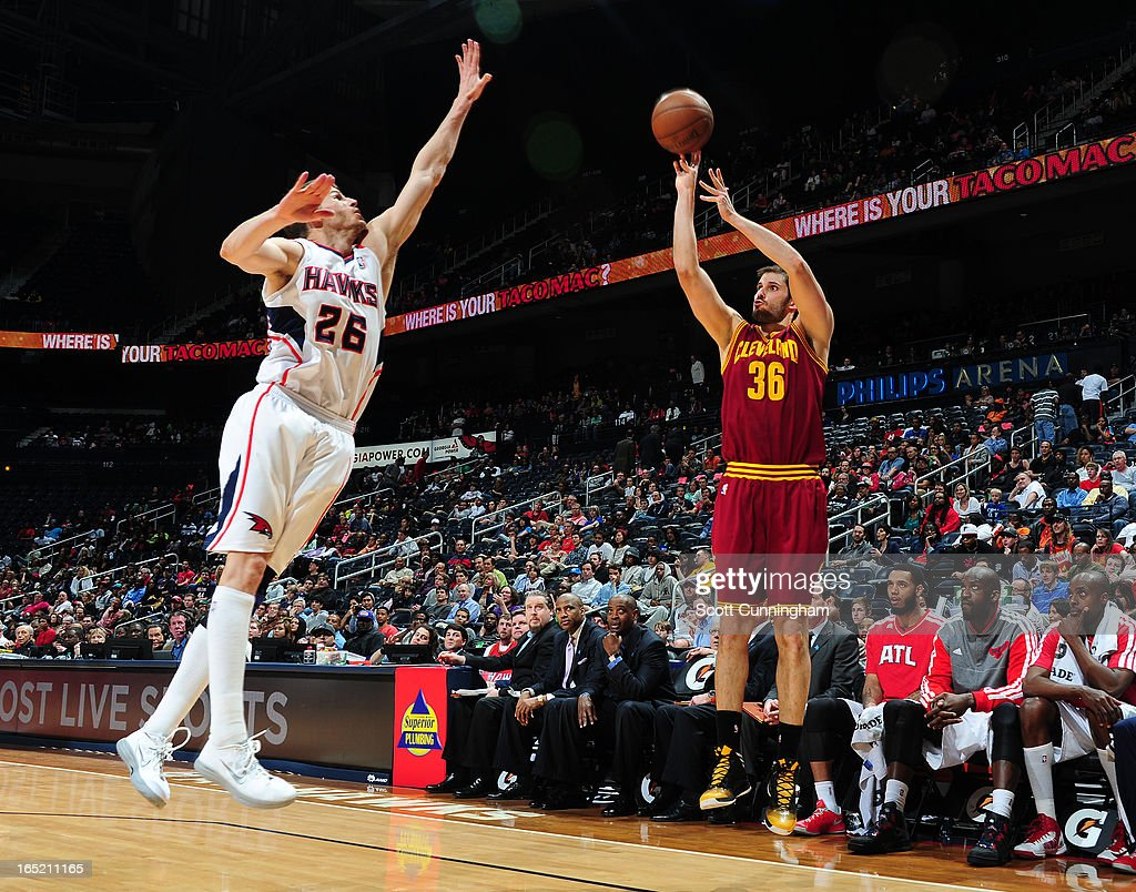 <a gi-track='captionPersonalityLinkClicked' href=/galleries/search?phrase=Omri+Casspi&family=editorial&specificpeople=2298404 ng-click='$event.stopPropagation()'>Omri Casspi</a> #36 of the Cleveland Cavaliers shoots a three pointer against <a gi-track='captionPersonalityLinkClicked' href=/galleries/search?phrase=Kyle+Korver&family=editorial&specificpeople=202504 ng-click='$event.stopPropagation()'>Kyle Korver</a> #26 of the Atlanta Hawks on April 1, 2013 at Philips Arena in Atlanta, Georgia.