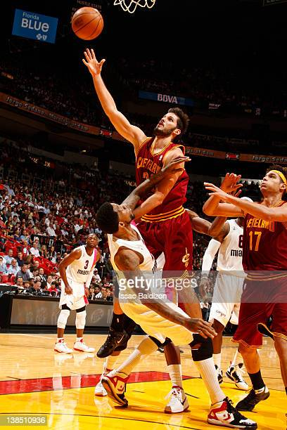 Omri Casspi of the Cleveland Cavaliers shoots against Udonis Haslem of the Miami Heat on February 7 2012 at American Airlines Arena in Miami Florida...