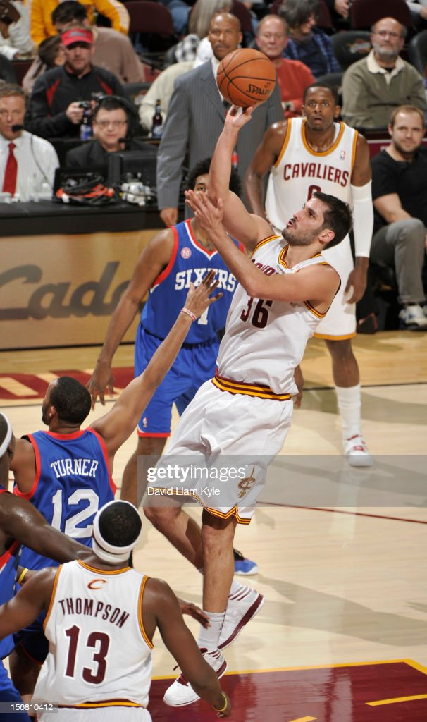 <a gi-track='captionPersonalityLinkClicked' href=/galleries/search?phrase=Omri+Casspi&family=editorial&specificpeople=2298404 ng-click='$event.stopPropagation()'>Omri Casspi</a> #36 of the Cleveland Cavaliers tosses up the shot against <a gi-track='captionPersonalityLinkClicked' href=/galleries/search?phrase=Evan+Turner&family=editorial&specificpeople=4665764 ng-click='$event.stopPropagation()'>Evan Turner</a> #12 of the Philadelphia 76ers at The Quicken Loans Arena on November 21, 2012 in Cleveland, Ohio.