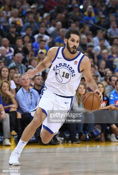 Omri Casspi of the Golden State Warriors drives towards the basket against the Washington Wizards during their NBA basketball game at ORACLE Arena on...