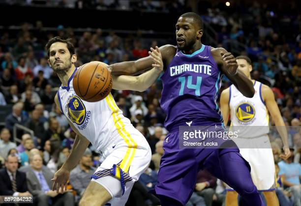 Omri Casspi of the Golden State Warriors goes after a loose ball against Michael KiddGilchrist of the Charlotte Hornets during their game at Spectrum...