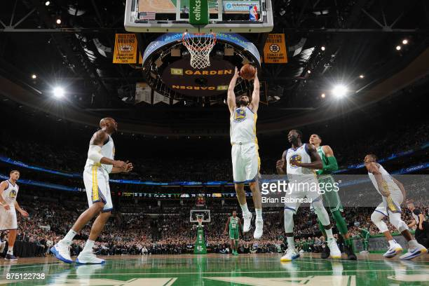 Omri Casspi of the Golden State Warriors grabs the rebound against the Boston Celtics on November 16 2017 at the TD Garden in Boston Massachusetts...