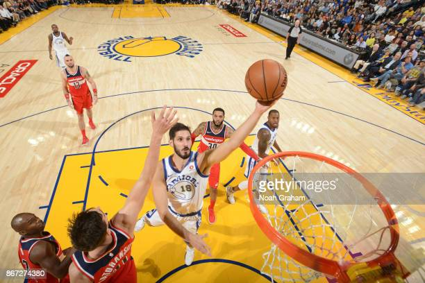 Omri Casspi of the Golden State Warriors shoots the ball against the Washington Wizards on October 27 2017 at ORACLE Arena in Oakland California NOTE...