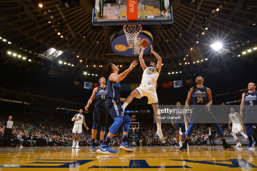 Omri Casspi #18 of the Golden State Warriors shoots the ball against the Dallas Mavericks on December 14, 2017 at ORACLE Arena in Oakland, California.