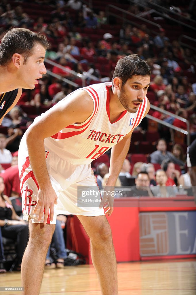<a gi-track='captionPersonalityLinkClicked' href=/galleries/search?phrase=Omri+Casspi&family=editorial&specificpeople=2298404 ng-click='$event.stopPropagation()'>Omri Casspi</a> #18 of the Houston Rockets battles for the rebound against the New Orleans Pelicans during the 2013 NBA pre-season game on October 5, 2013 at the Toyota Center in Houston, Texas.