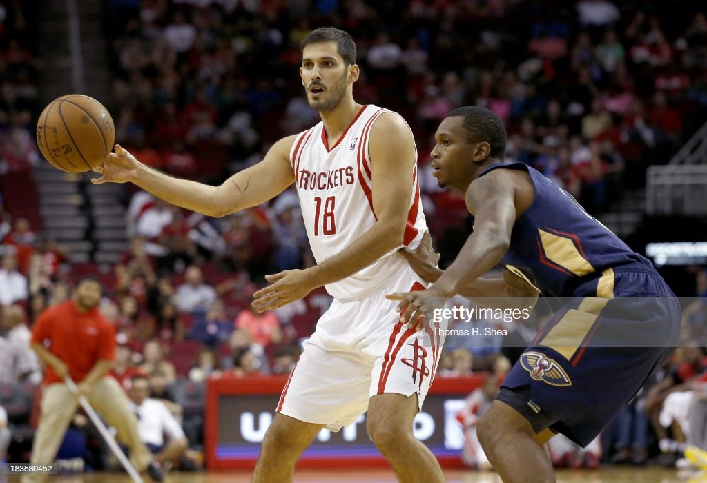 Omri Casspi #18 of the Houston Rockets dribbles against Lance Thomas #42 of the New Orleans Pelicans in a preseason NBA game on October 5, 2013 at Toyota Center in Houston, Texas. The Pelicans won 116 to 115.