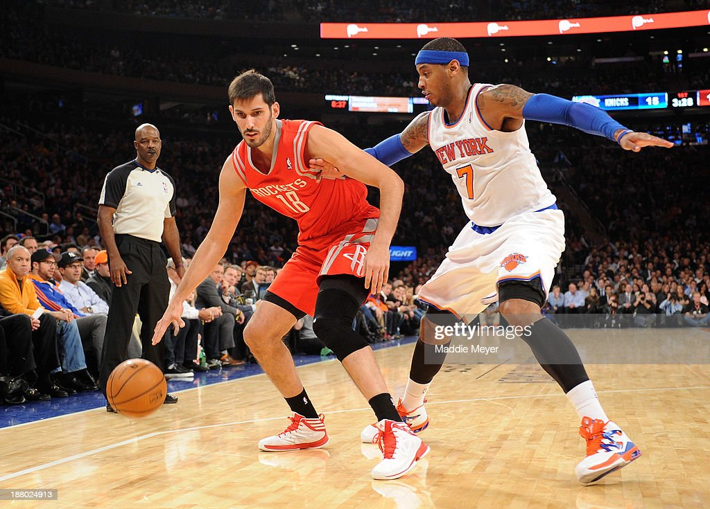 Omri Casspi #18 of the Houston Rockets drives against J.R. Smith #8 of the New York Knicks during the first quarter at Madison Square Garden on November 14, 2013 in New York City.