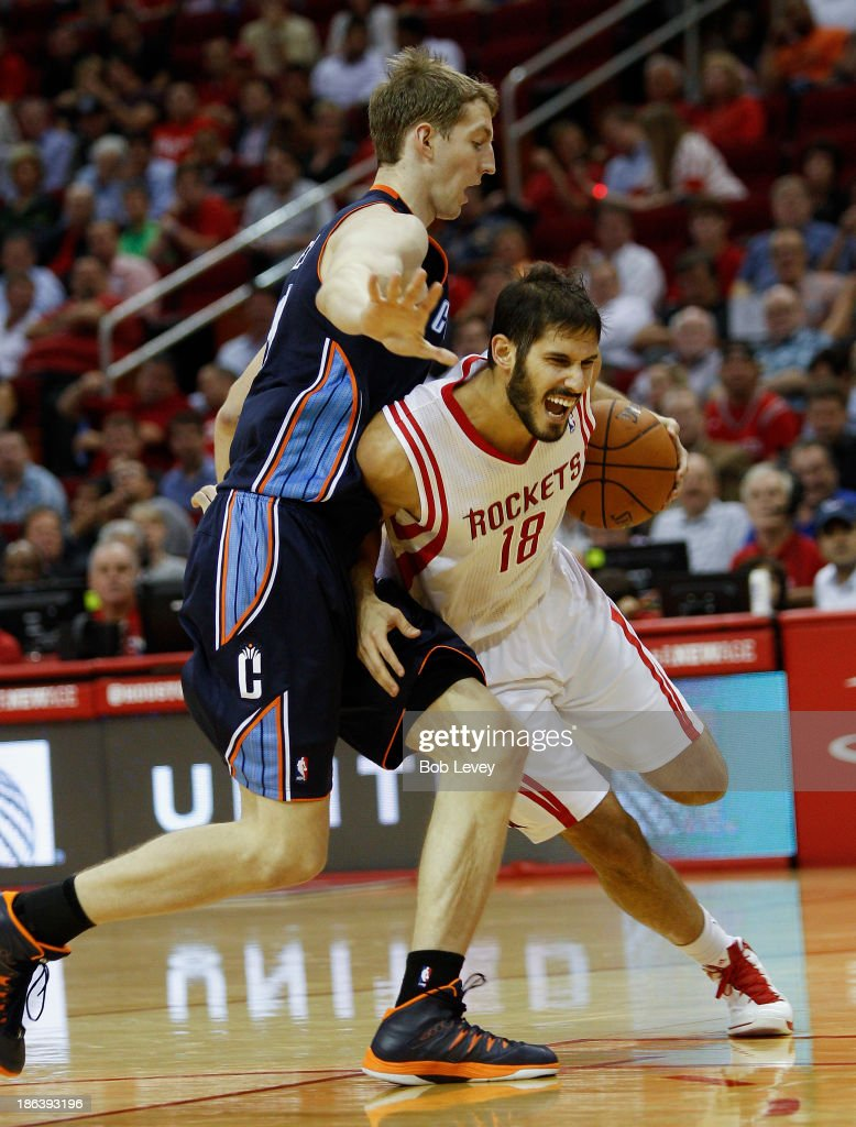 <a gi-track='captionPersonalityLinkClicked' href=/galleries/search?phrase=Omri+Casspi&family=editorial&specificpeople=2298404 ng-click='$event.stopPropagation()'>Omri Casspi</a> #18 of the Houston Rockets drives around <a gi-track='captionPersonalityLinkClicked' href=/galleries/search?phrase=Cody+Zeller&family=editorial&specificpeople=7621233 ng-click='$event.stopPropagation()'>Cody Zeller</a> #40 of the Charlotte Bobcats at Toyota Center on October 30, 2013 in Houston, Texas.