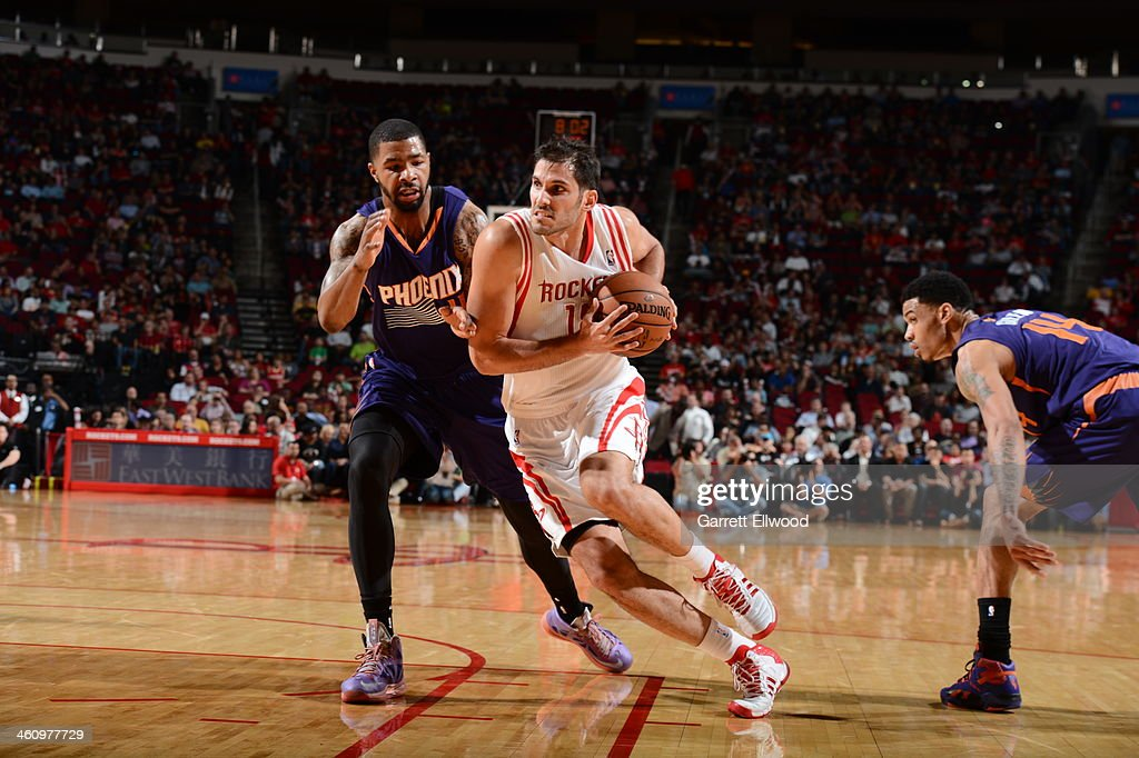 <a gi-track='captionPersonalityLinkClicked' href=/galleries/search?phrase=Omri+Casspi&family=editorial&specificpeople=2298404 ng-click='$event.stopPropagation()'>Omri Casspi</a> #18 of the Houston Rockets drives to the basket against the Phoenix Suns on December 4, 2013 at the Toyota Center in Houston, Texas.