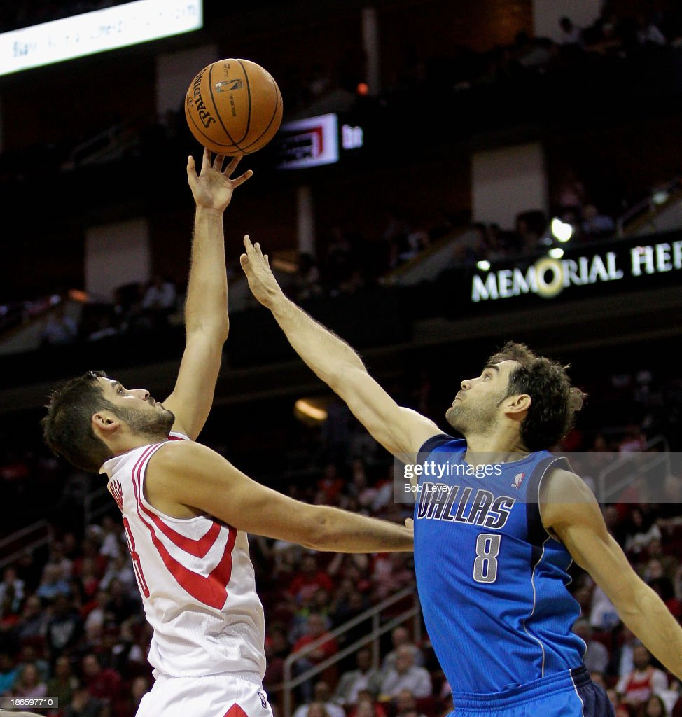 <a gi-track='captionPersonalityLinkClicked' href=/galleries/search?phrase=Omri+Casspi&family=editorial&specificpeople=2298404 ng-click='$event.stopPropagation()'>Omri Casspi</a> #18 of the Houston Rockets shoots over <a gi-track='captionPersonalityLinkClicked' href=/galleries/search?phrase=Jose+Calderon&family=editorial&specificpeople=548297 ng-click='$event.stopPropagation()'>Jose Calderon</a> #8 of the Dallas Mavericks in the fourth quarter at Toyota Center on November 1, 2013 in Houston, Texas.