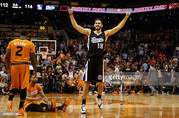 Omri Casspi of the Sacramento Kings celebrates alongside Eric Bledsoe and Marcus Morris of the Phoenix Suns after the Kings defeated the Suns 114112...