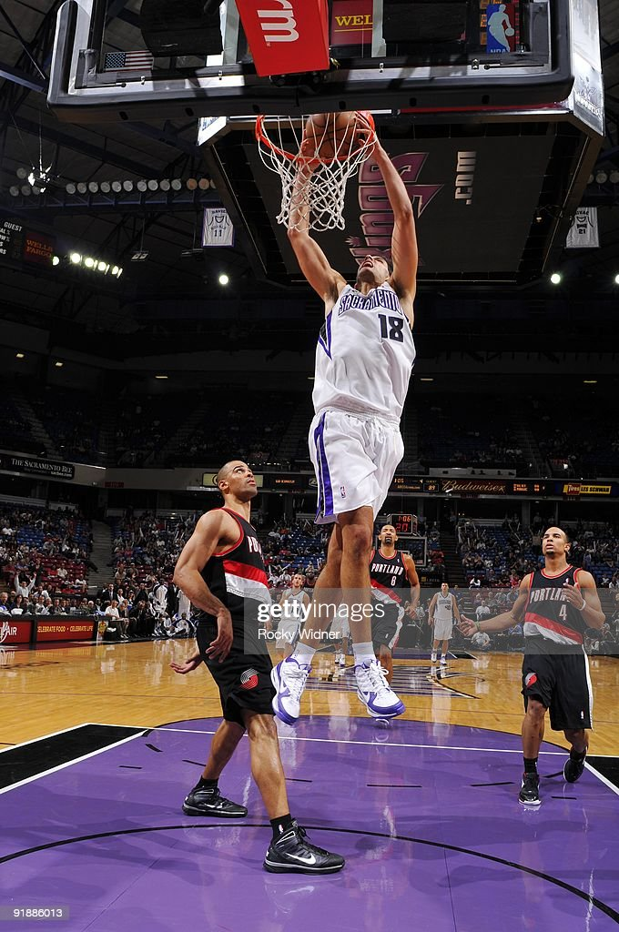 Omri Casspi #18 of the Sacramento Kings dunks against Ime Udoka #3 of the Portland Trail Blazers during the preseason game at Arco Arena on October 7, 2009 in Sacramento, California. The Blazers won 89-86.