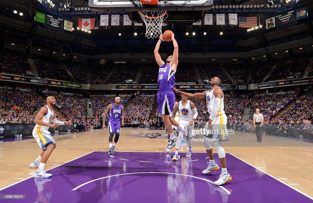 Omri Casspi #18 of the Sacramento Kings dunks against the Golden State Warriors on October 29, 2014 at Sleep Train Arena in Sacramento, California.