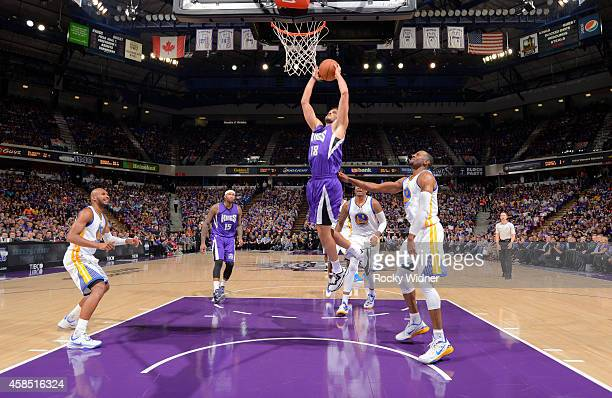 Omri Casspi of the Sacramento Kings dunks against the Golden State Warriors on October 29 2014 at Sleep Train Arena in Sacramento California NOTE TO...