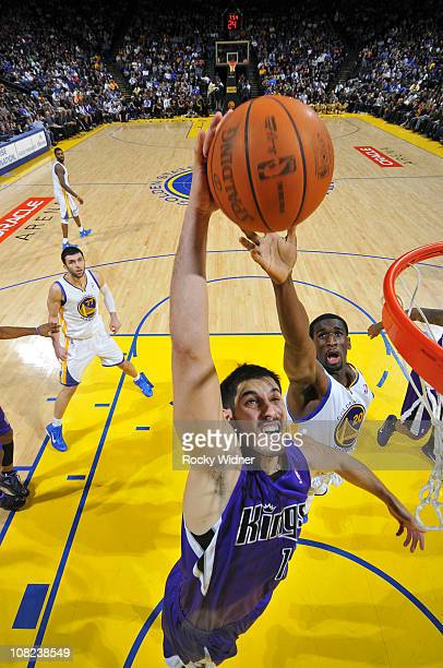 Omri Casspi of the Sacramento Kings dunks the ball against Ekpe Udoh of the Golden State Warriors on January 21 2011 at Oracle Arena in Oakland...