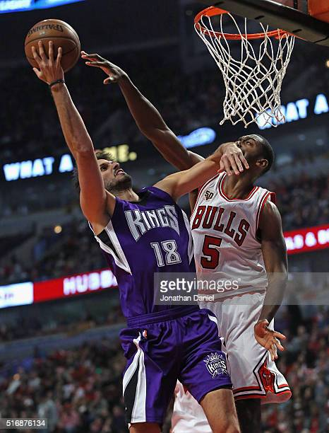 Omri Casspi of the Sacramento Kings hits Bobby Portis of the Chicago Bulls in the face as he goes up for a shot at the United Center on March 21 2016...