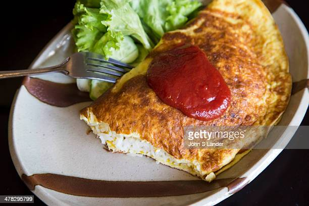 Omrice or 'omuraisu' as it is usually pronounced is basically an omelette filled with rice It is typically served with a dollop of ketchup on top