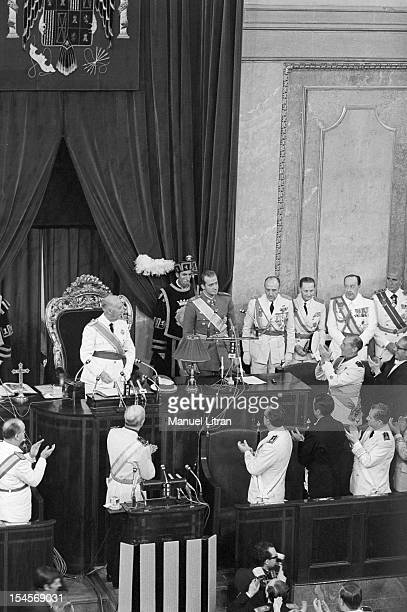 On 24 July 1969 the gallery of the palace of the Cortes in Madrid Spain FRANCO with glasses standing presiding the Meeting and his successor Prince...