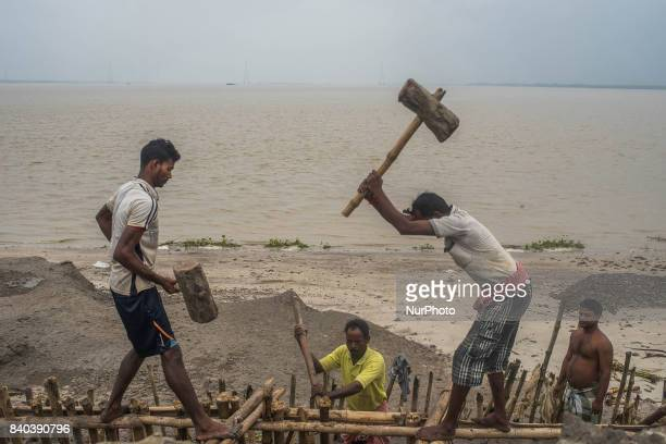 On 28 August 2017 in Ghoramara India The villagers try to repair the barrage every time when it breaks apart due to extensive tidal water pressure...
