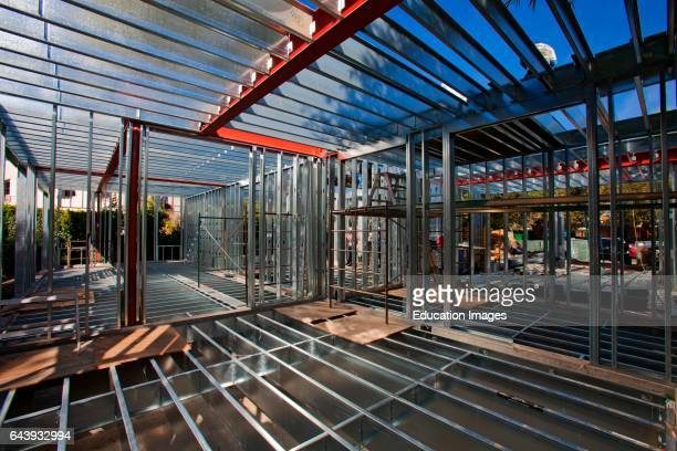 On 3/14/2013 the steel framing continues to be assembled over the foundation on the Begley's new home Steel while not a common material for...
