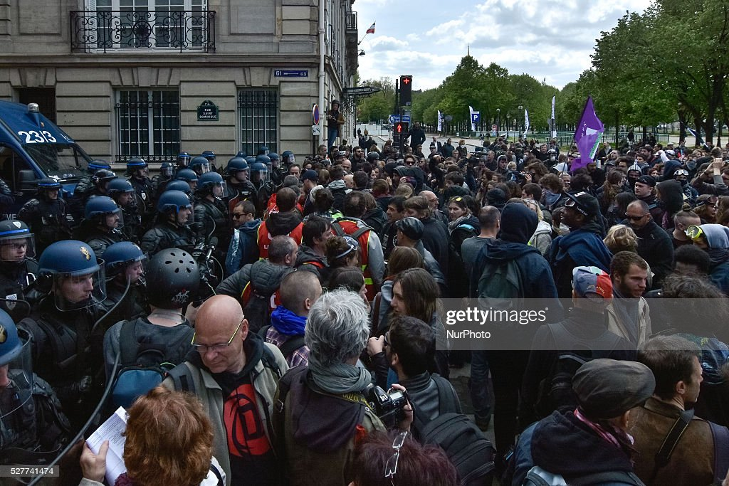 """On 3rd May 2016 in Paris, France, protest march of the students and Trade Union. The student came first at 11 am in """"Montparnasse"""" and march through """"les invalides"""" to join the united syndicates for a sitting . The streets to the """" assembl��e generale """" was blocked by police and no one can pass."""