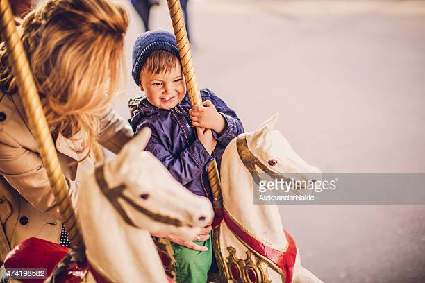 On a carousel ride