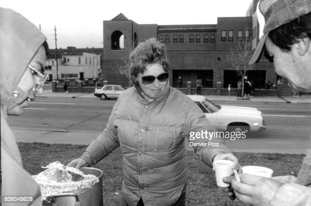 On a cold day hot soup for the hungry Bonnie Adams of Broomfield serving soup and donuts along with Ron Olson to one of Denver's many homeless men Ms...