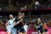 On A Kim of South KoKorea throws the ball against Begona Fernandez Molinos of Spain during the Women's Handball Bronze Medal Match on Day 15 of the...