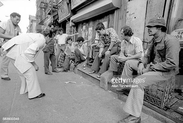 On a Lower East Side sidewalk a group of men shoot craps for money New York New York September 9 1974
