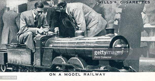 On a Model Railway' number 20 of 50 from the 'Our King And Queen' cigarette cards produced for WD HO Wills The Imperial Tobacco Company 1937 The Duke...