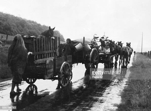 On a rainy day exodus of French refugees who leave their town and houses May 1940 France World War II
