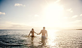 Shot of a carefree couple enjoying a swim in the ocean